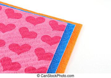 Orange, pink and blue napkins over white