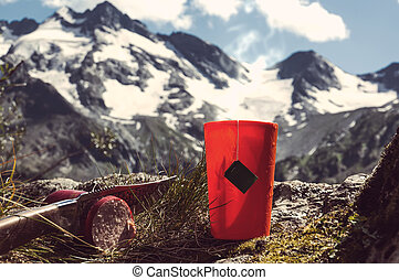 mug with strong tea and tea bag on a snowy winter background.