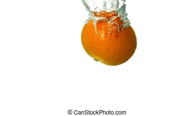 Orange plunging into water