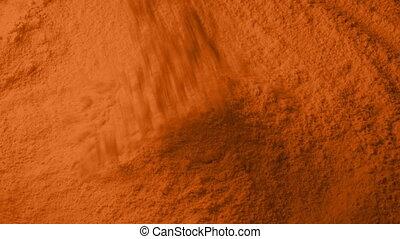 Orange Powder Pours Into Pile - Orange powder pours into...