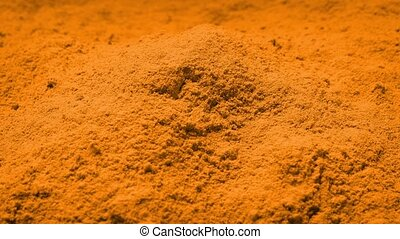 Orange Powder Rotating - Pile of orange powder turning...