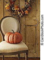 Orange pumpkin on chair