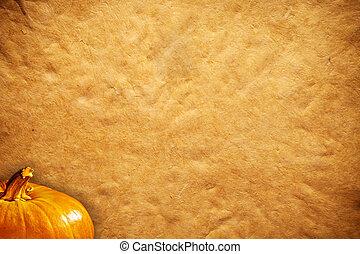 orange pumpkins and sheet of paper background