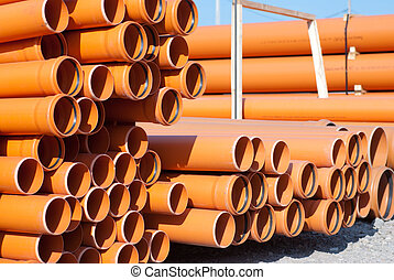 Orange PVC pipes - construction material