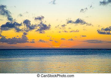 orange rays of the sun at sunset