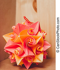 Orange red paper rose. Origami. Hanging handmade toy