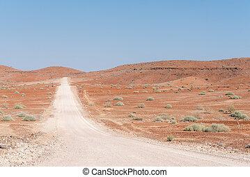 Orange-red, rocky Namib desert landscape at Dopsteekhoogte Pass