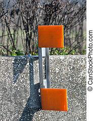 Orange reflector on road - Orange reflector on cement guard...
