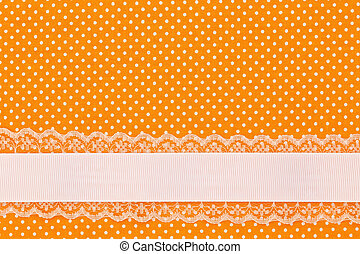 Orange retro polka dot textile background with ribbon