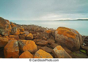 Orange Rocky Coastline