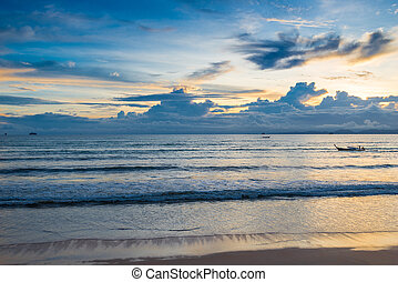 Orange roll and blue heavy clouds over the sea in the tropics