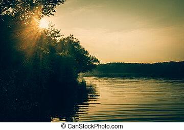 orange romantic sunset in the pond