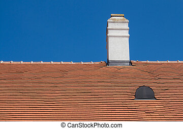Orange roof with a chimney