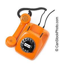 orange rotary phone on white background