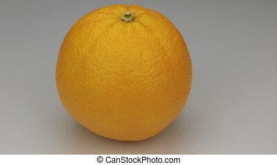 Orange rotates on its axis.