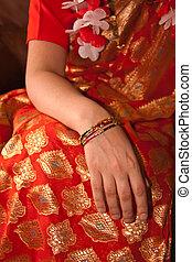 Orange Sari with Bangled wrist