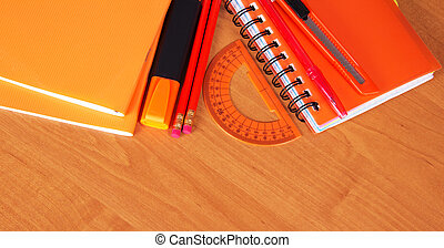 Orange school accessories - Exercise books, the notepad,...