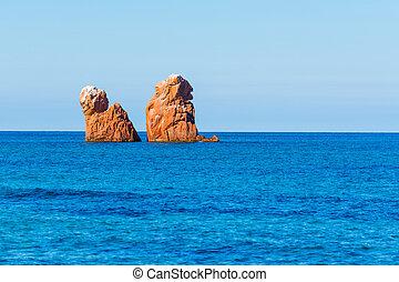 orange sea stacks in Cea Beach