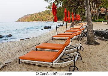 Orange seats in the beach