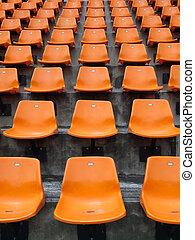 Orange seats on the stadium vertical