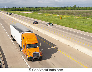Orange Semi Truck Trailer Rig Hauls Freight on Divided Highway