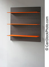Orange shelf - Empty orange shelf hanging on the wall