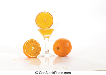 orange slice falls in a glass