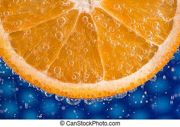 Orange slice in bubbles