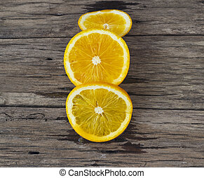 Orange sliced on wooden table