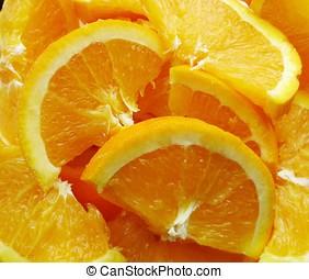 orange slices - A pile of sliced naval oranges