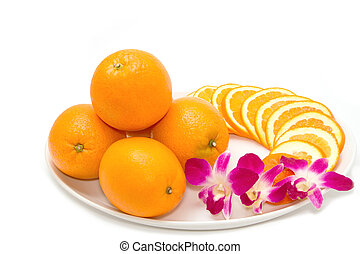 Orange slices decoration with orchid in white plate