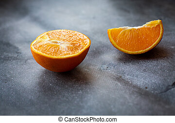 orange slices on a gray background