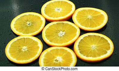 Orange slices on dark desk - From above orange slices on...