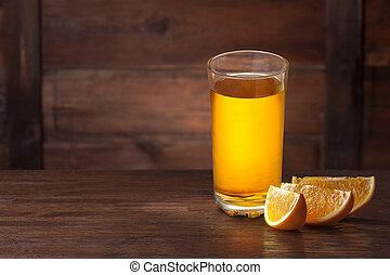 Orange slices on wood