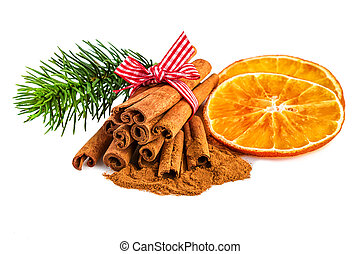Orange slices with cinnamon on white. Christmas rustic decoration on white background.