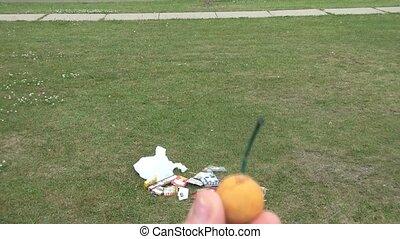 Orange Smoke Bomb Lit - Lighting an orange smoke bomb with...