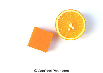 Orange soap and half navel orange - Orange soap bar and a...