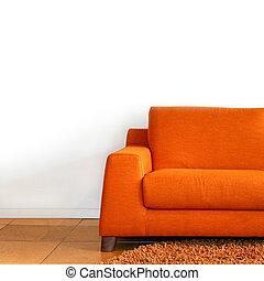 Comfort orange textile sofa in living room