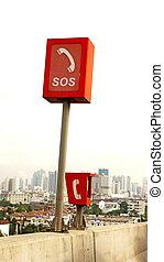 Orange SOS phone box at the highway