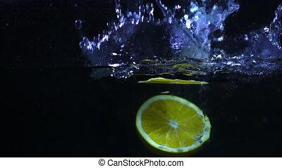 Orange splashing slow motion