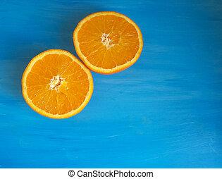 Orange split in half on a blue background