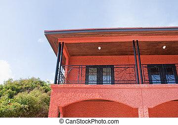 Orange Stucco and Black Wrought Iron Building in Tropics