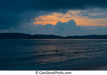 orange sun sets in the clouds over the Andaman Sea, Thailand