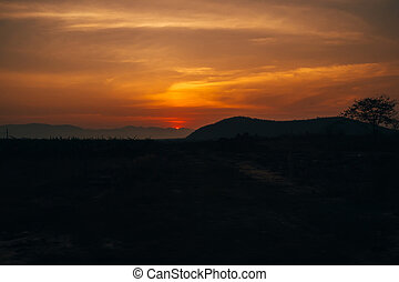 sunrise on the background of the silhouette of the mountains