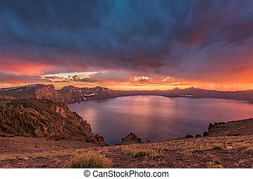 Orange Sunset and Storm Clouds Over Crater Lake