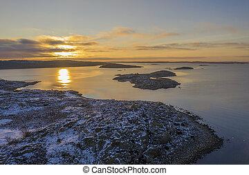 Orange sunset at the coast drone photo