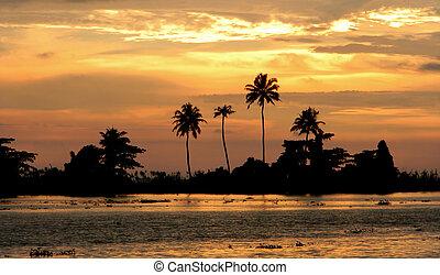Orange sunset in Kerala India - Orange sunset on the ...