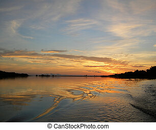 Orange sunset on the Rio Negro in the Amazon River basin, Brazil, South America