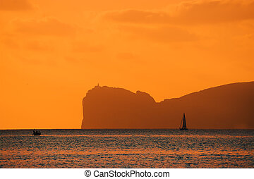 orange sunset over Capo Caccia