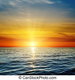 orange sunset over dark blue sea
